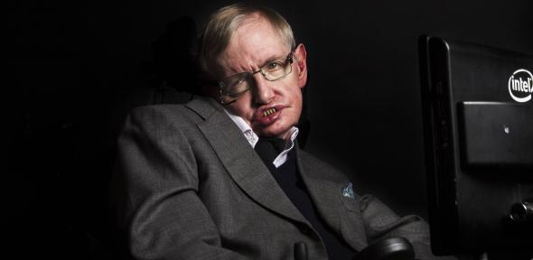 hawking_with_newtons_copy_of_principia_mathematica-_please_credit_graham_copekoga